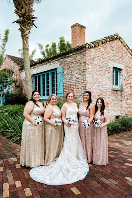 Bride and bridesmaids in gold and pink sequin dresses