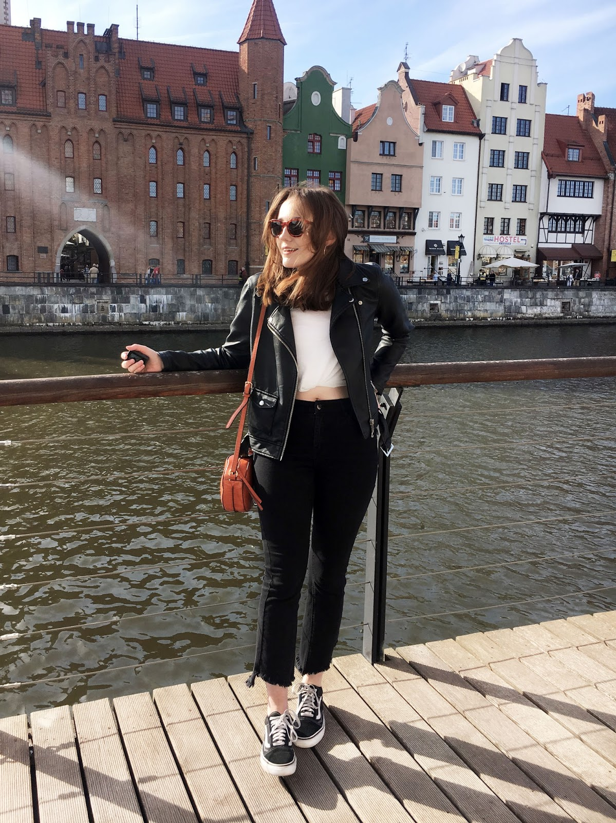 simple vacation look for a European city break ft. jeans, t shirt, vans and biker jacket