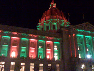 San Francisco City Hall lit in red and green, phone photography by A.E. Graves