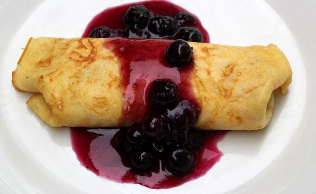 Get our simple cheese blintz crepe recipe with fresh homemade blueberry sauce. It's the perfect brunch, breakfast, or dessert dish!