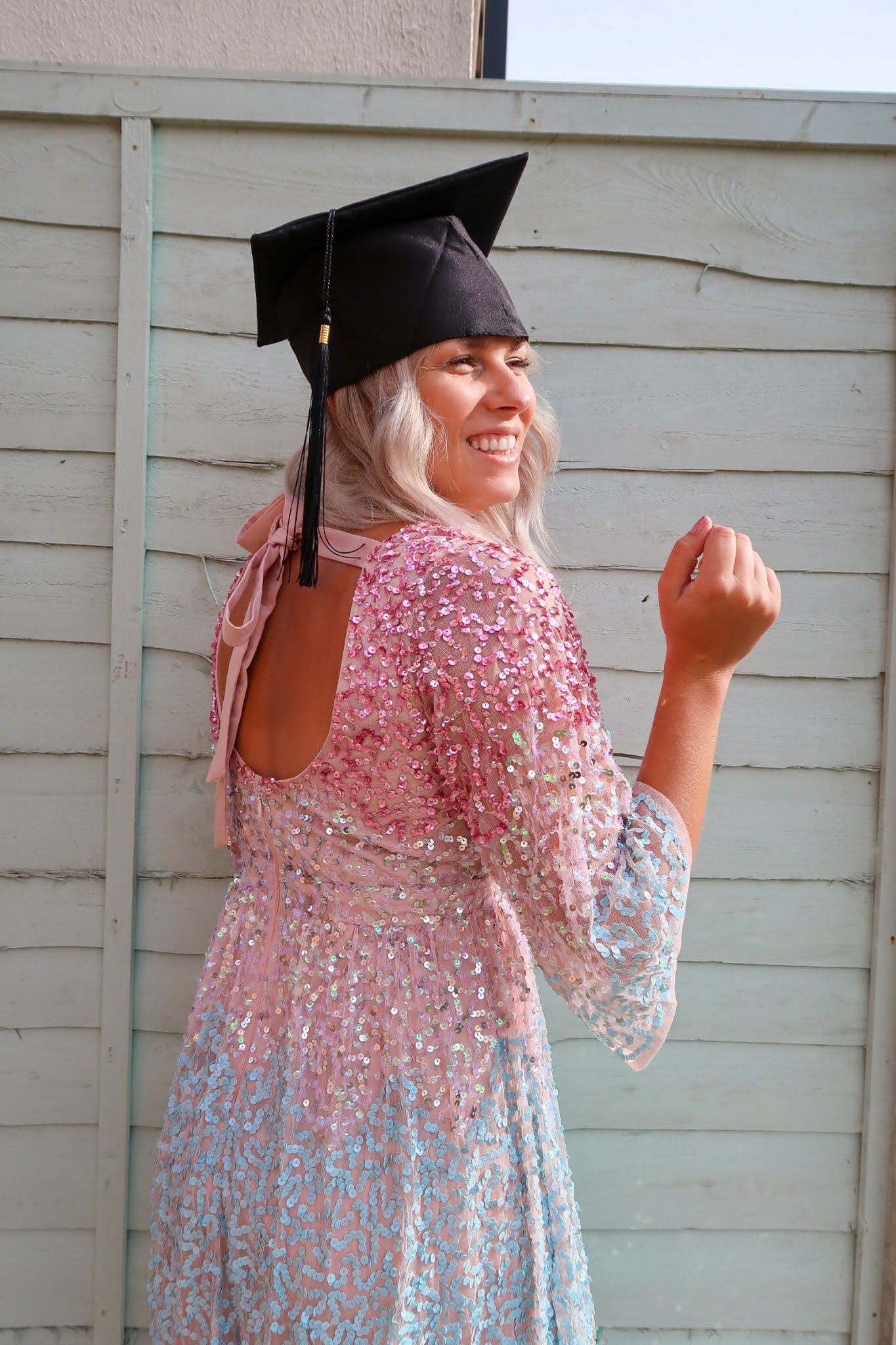 Rachel Emily wearing a rainbow Maya Deluxe Sequin Dress and Graduation Hat - Rachel Emily Blog