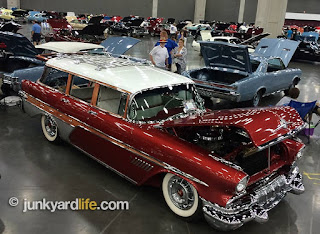 A beautiful Candy Apple red 1957 Pontiac wagon takes the floor at POCI show.