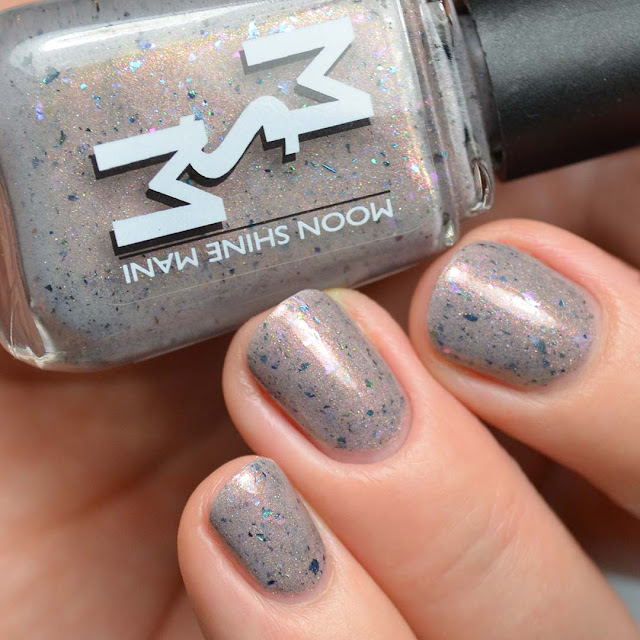taupe nail polish with shimmer and flakies swatch