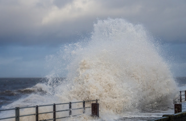 Photo of a giant wave crashing onto Maryport Promenade