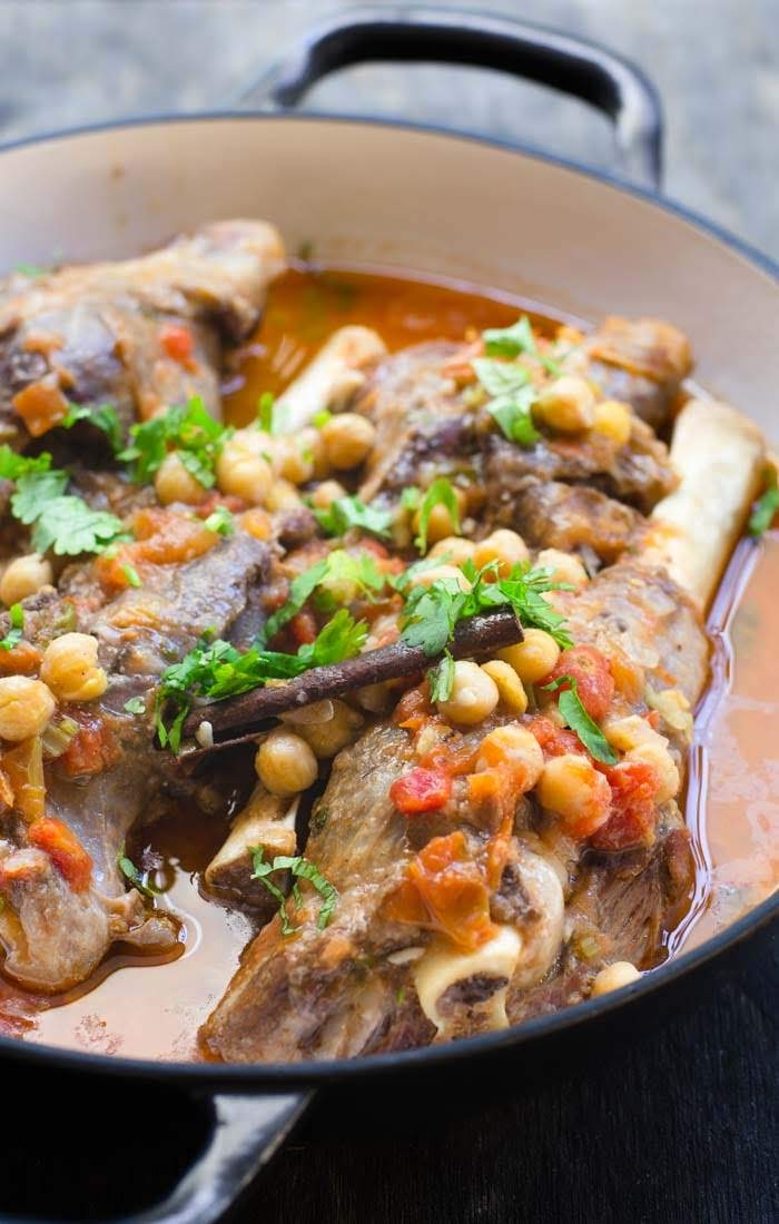 A pot of slow cooked lamb shanks image