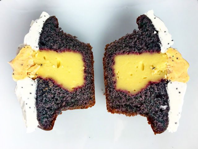 Cross Section of Fully Frosted Blueberry Cupcake