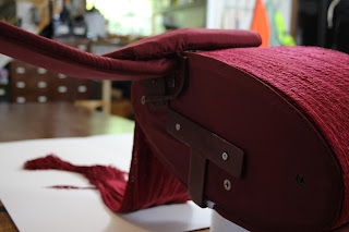 The fully supportive custom made 3D mount for an 18th century red silk officer's sash, conservation, historic garments, textile conservator Gwen Spicer of Spicer Art Conservation, Military artifacts, collectibles, antiques, display and exhibit, restoration, repair, preservation