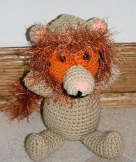 http://translate.google.es/translate?hl=es&sl=de&tl=es&u=http%3A%2F%2Ftacomagic.wordpress.com%2F2011%2F12%2F21%2Fwednesday-geek-craft-34-crocheted-not-a-lion%2F