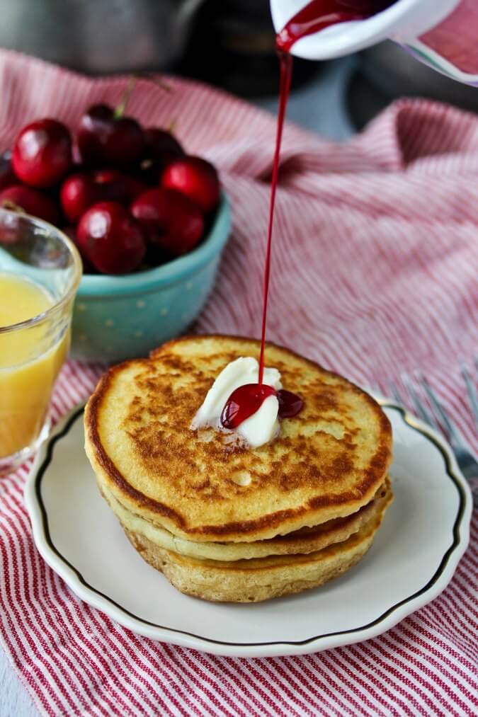 Sourdough Pancakes with Hibiscus Syrup poured over the pancakes