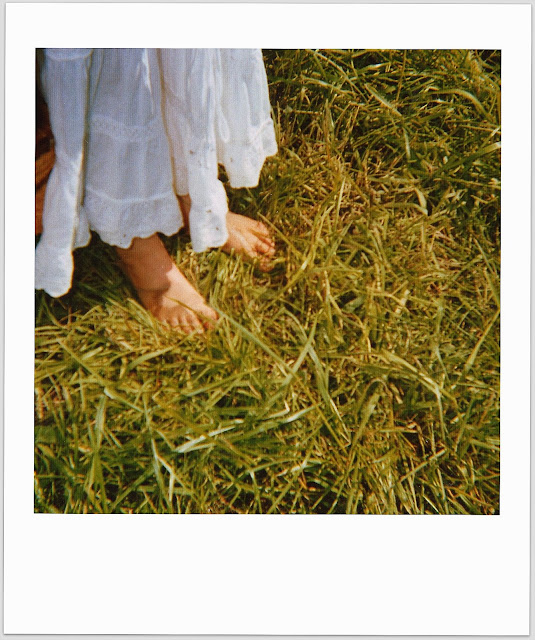 child feet in grass