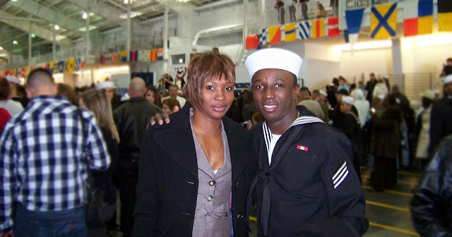 ENS Kiendrebeogo and wife at the enlisted boot camp graduation, May 2010. [Photo credit: Courtesy of ENS Kiendrebeogo]