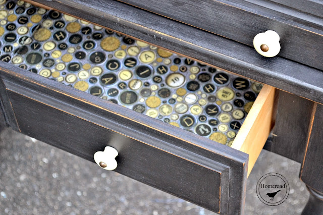 Open drawer with typewriter key lining.