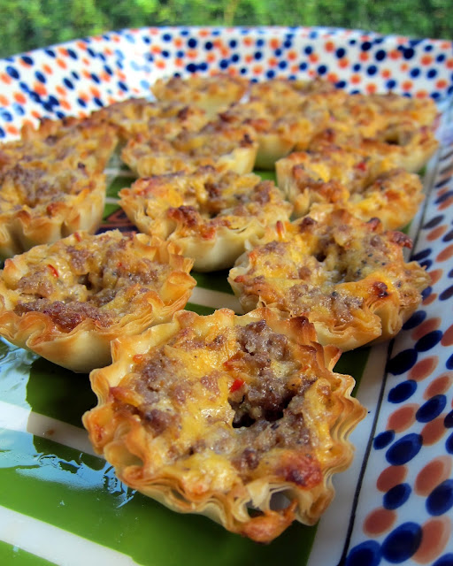 Spicy Sausage and Cheese Tarts - only 4 ingredients! Can make ahead of time and freeze for a quick snack later. People go crazy over these tarts! I always have a batch in the freezer! SO good!