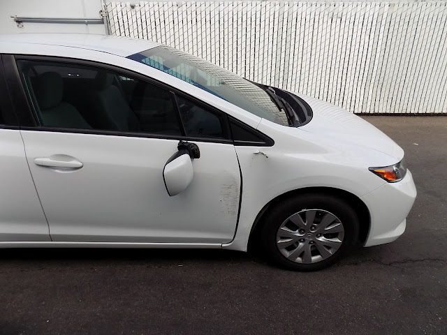 2013 Honda Civic with auto body damage before repairs at Almost Everything Auto Body.