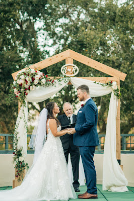 ceremony under arch at timacuan