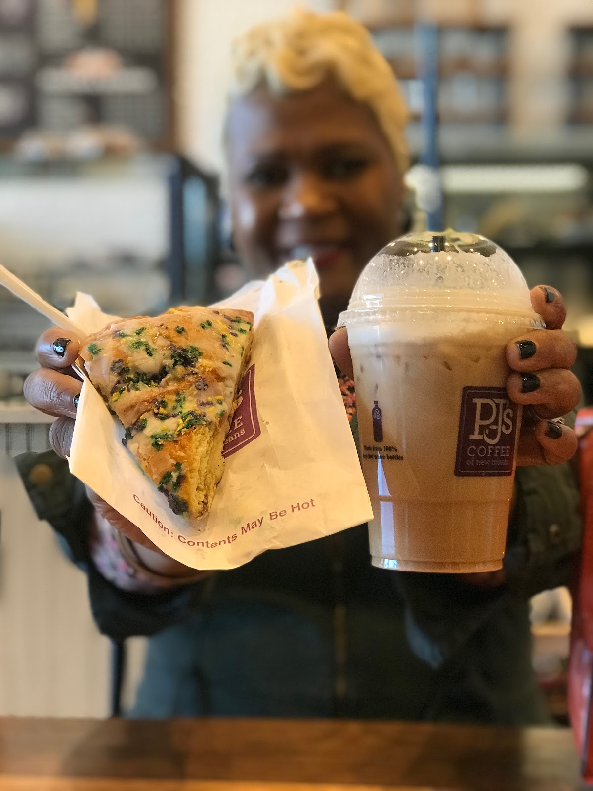 Tangie Bell trying a Mardi Gras King cake and Latte : City Diaries