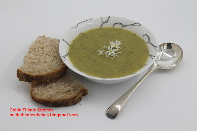 Bowl of wild garlic soup with bread