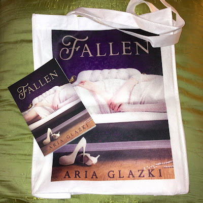 Fallen novel and tote bag featuring the cover