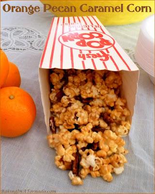 Orange Pecan Caramel Corn, a crunchy, sweet, citrus and totally addicting snack. | Recipe developed by www.BakingInATornado.com | #recipe #snack