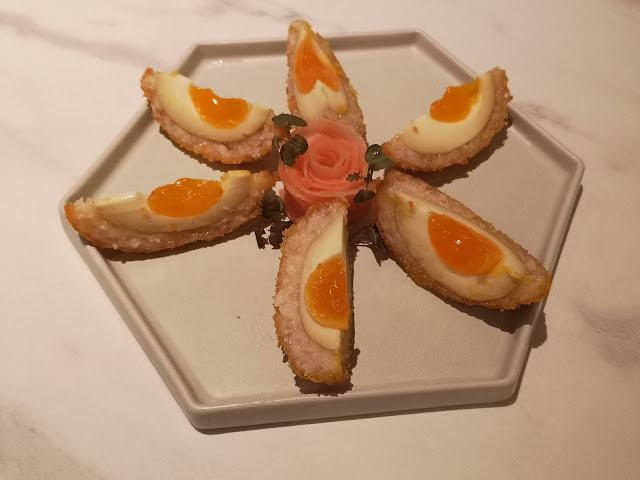 Deep-fried marinated egg coated with prawn paste