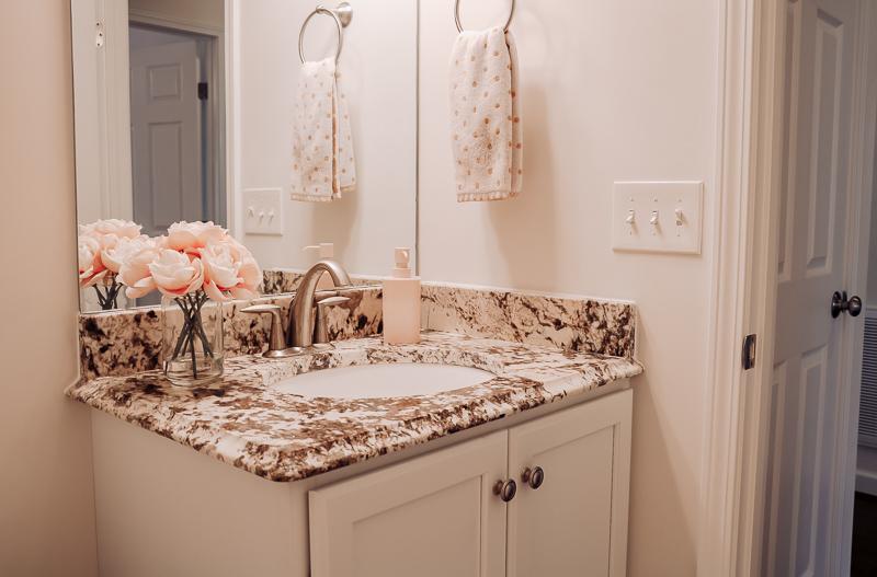 white blush hall bathroom