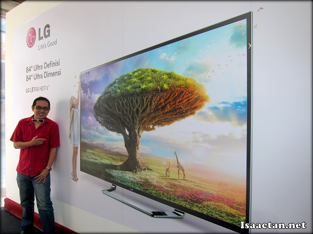 Isaac just chilling with the LG 84 inch HDTV banner