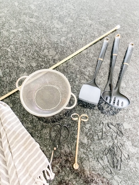 spring rod with hooks for kitchen storage