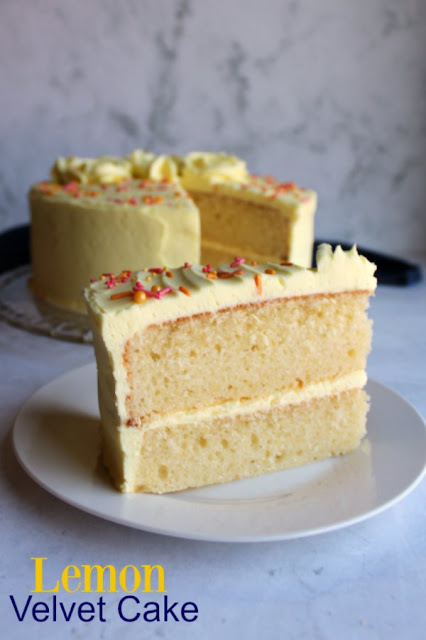 Layers of soft lemon cake wrapped in a luscious lemon frosting, this citrus twist on a velvet cake is a must make.  The recipe is super simple to make.  There's no butter to soften or crazy ingredients to get.  You'll have it in the oven in no time and you'll be thanking your lucky stars after the first bite!