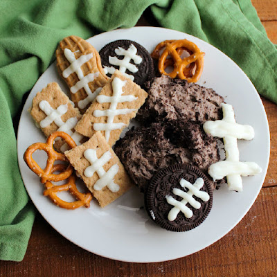 plate with chocolate cheese ball and cookies, graham cracker and pretzel dippers