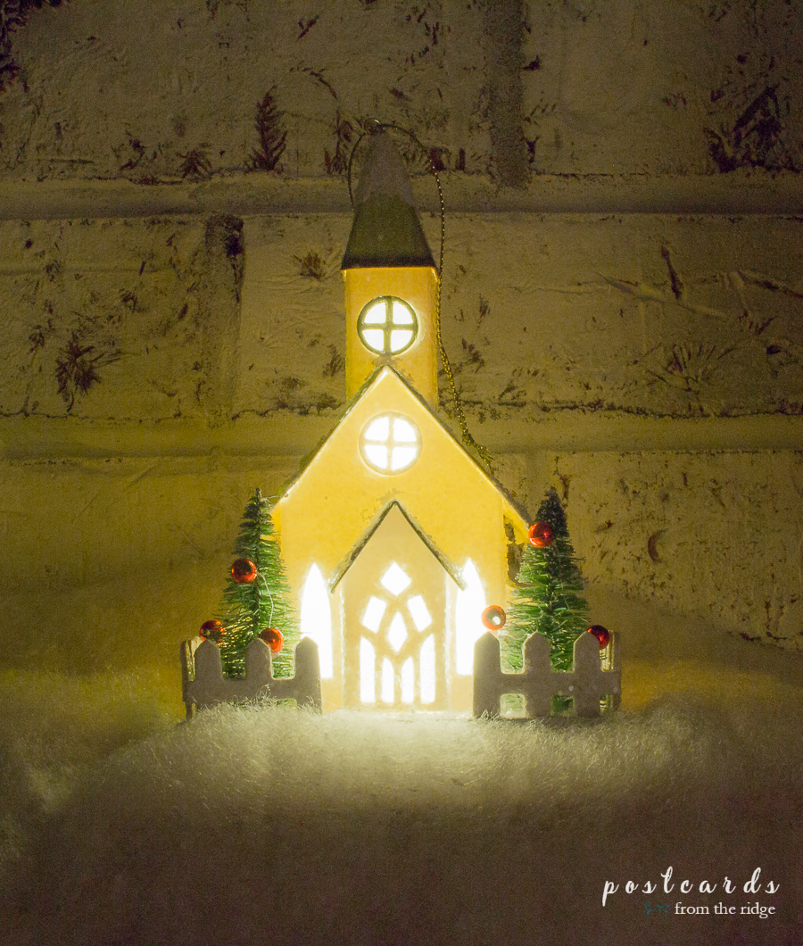 LED paper Christmas church on a farmhouse style mantel