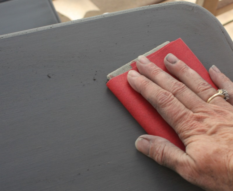 Step 3 use 220-grit sandpaper wrapped around a sanding pad.