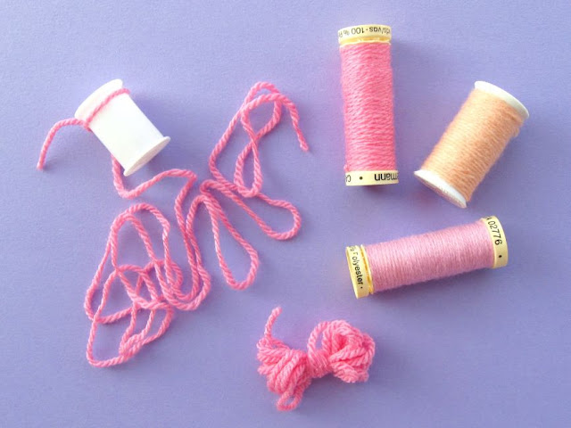 wrap the empty reels with leftover bits of yarn