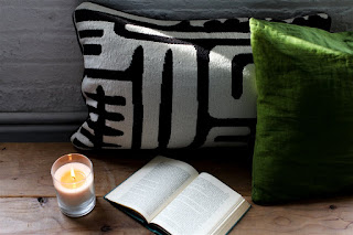 Candle, Pillow, and Books