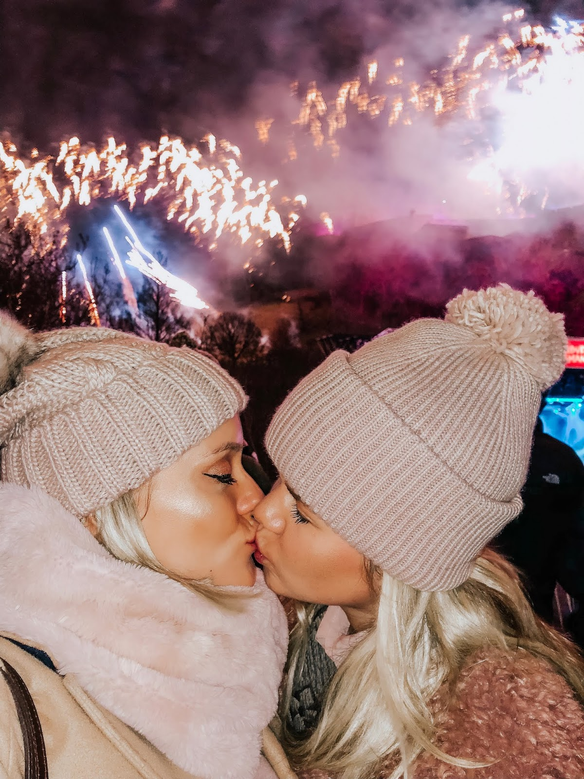 lesbian couple, whitney and megan, kissing on new years eve at Edinburgh's Hogmanay