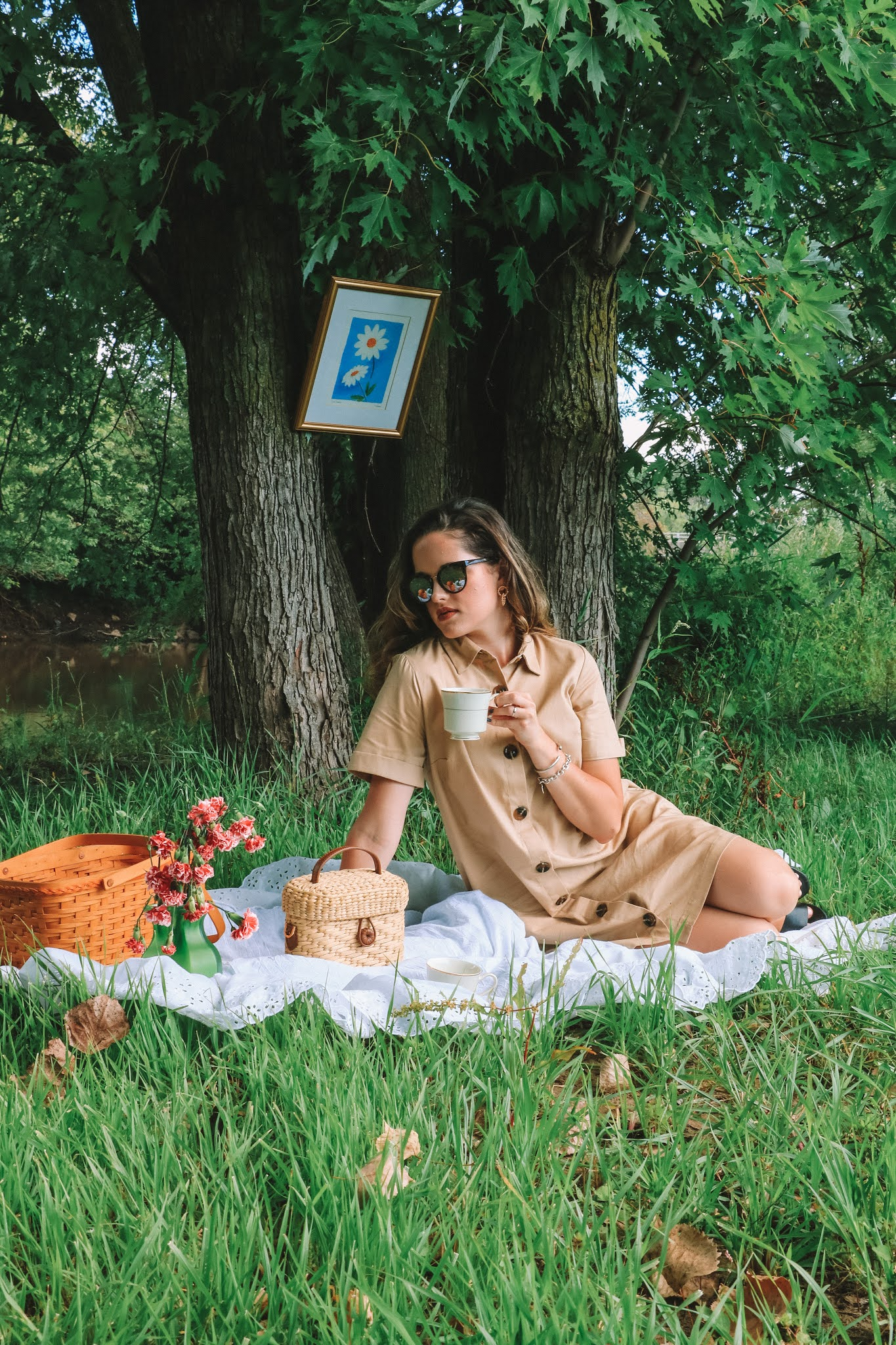 Fashion blogger Kathleen Harper having a picnic in the forest for her cottagecore aesthetic.
