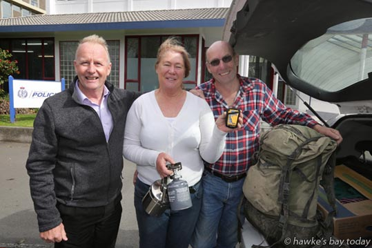 L-R: Detective senior sergeant Marty James; Marie Cresswell, Clive Cresswell, Tolaga Bay, pictured at the Hastings Police Station after recovering their tramping equipment, after being rescued by police, LandSAR, Land Search and Rescue, and the Lowe Corporation Rescue Helicopter, after activating their PLB Personal Locator Beacon in the Ruahine Range eastern foothills area between Sparrow Hawk Spur and Colenso Spur, Central Hawke's Bay. photograph