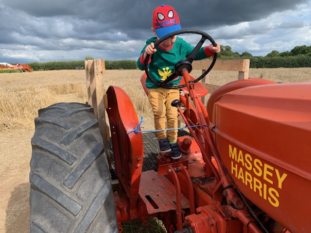 Little boy on a red tractor