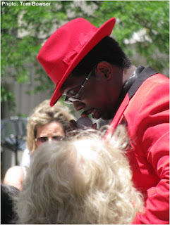 Theo Huff interacting with women in the crowd at the 2016 Chicago Blues Festival Preview event at Chicago's Daley Plaza | Photograph by Tom Bowser