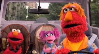 Elmo's father Louie, Elmo, Abby Cadabby. Sesame Street Elmo's Travel Songs and Games
