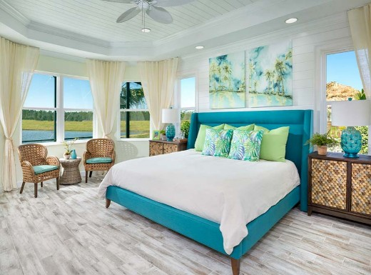 Blue Upholstered Bed In A Bedroom With Tropical Vibe