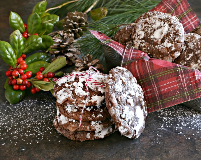 Recipe for soft, fudgy chocolate cookies, filled with peanut butter chips and rolled in powdered sugar.