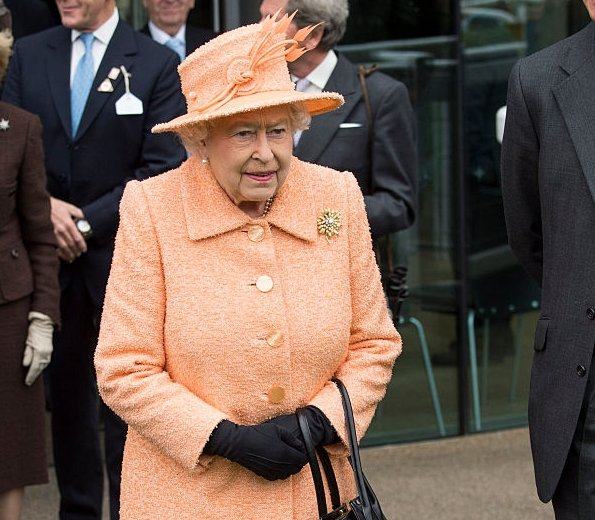 Queen Elizabeth II with the Queen Elizabeth ll Stakes trophy at Qipco Champions Day at Ascot Racecourse