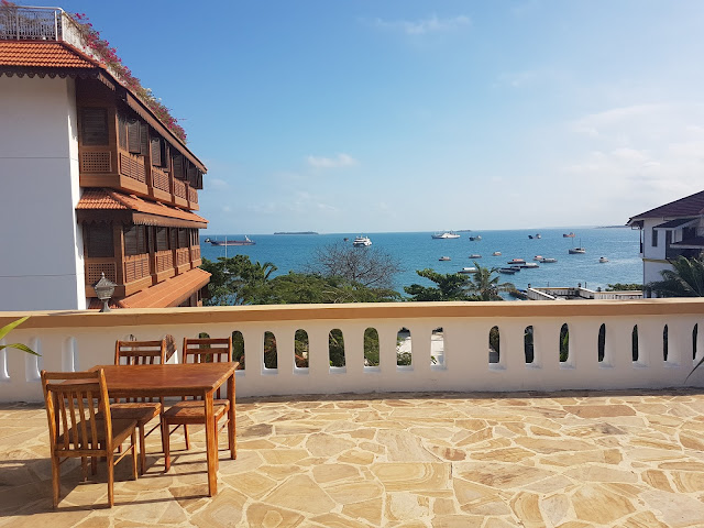 The ocean seen from across Abuso Inn's Rooftop Dining Area, in StoneTown, Zanzibar. To the left is the Park Hyatt