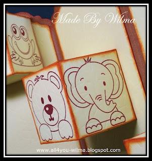 Een kikker, een beer en een olifant gestempeld op verschillende zijden van 2 verschillende doosjes. A frog, a bear and an elephant stamped on different sides of 2 different boxes.