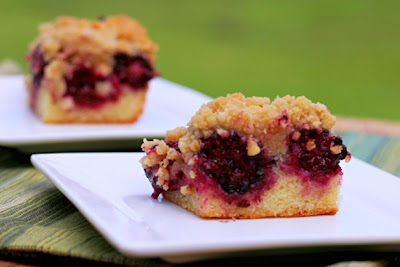 blackberry crumb cake on a white plate