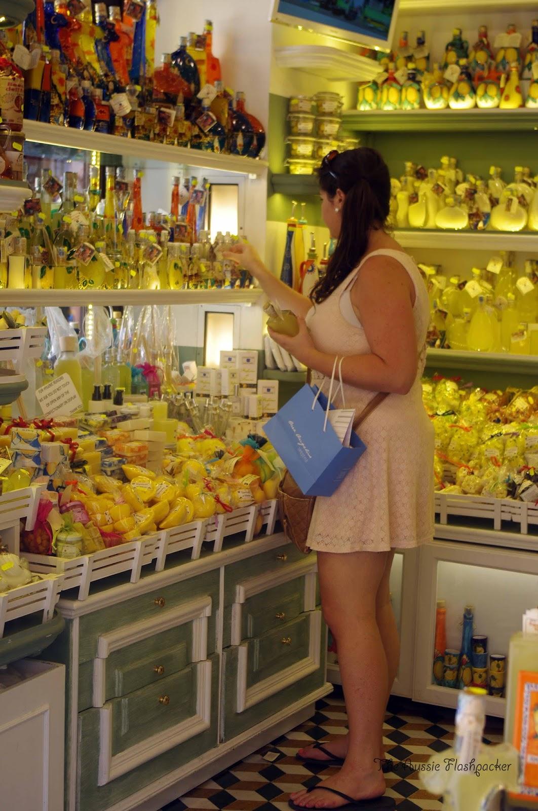 Girl shopping for Limoncello in Amalfi