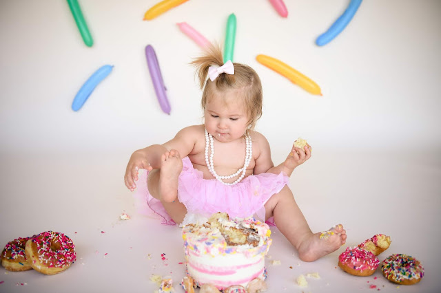 Using her toes for a cake smash