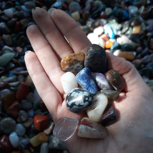 Gemstones in a hand