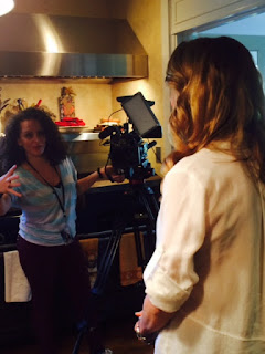 presenter and camerawoman setting up in kitchen for TV segment on breakfasts
