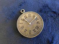 A brass clock pendant